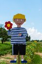 Pick your flowers handcrafted boy symbol promoting a field to own Royalty Free Stock Images