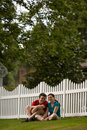 Picket Fence Couple-Vertical Royalty Free Stock Photo