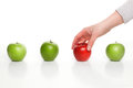Picking different apple hand red among green apples Royalty Free Stock Photo