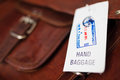 Picking up baggage hand and label at the airport Royalty Free Stock Photos