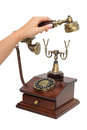 Picking up old-fashioned phone receiver Royalty Free Stock Photo