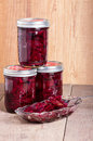 Pickled beets in jars and bowl red mason being served a Royalty Free Stock Image