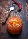 Pickled bulgarian peppers in a glass jar selective focus Stock Photos