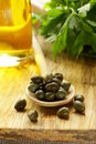 Pickled capers in a wooden spoon Stock Images