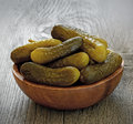 Pickled cucumbers in bowl on a wooden table Royalty Free Stock Image