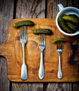 Pickled cucumbers   on a fork Royalty Free Stock Photo
