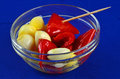 Pickled garlic spicy pimento peppers vinegar olive oil served clear glase hors d oeuvres bowl Royalty Free Stock Images