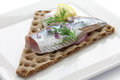 Pickled herring on crisp bread Stock Image