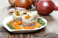 Pickled herring rolls with vegetables on wooden table Royalty Free Stock Photo