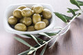Pickled olives green in a white bowl Stock Photos