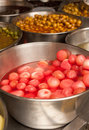 Pickled onions container with and olives Stock Photography
