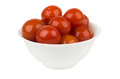 Pickled red tomatoes in bowl isolated on white background Royalty Free Stock Photo