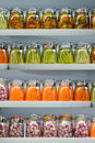 Pickled vegetables in glass jars on shelves Royalty Free Stock Image