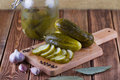 Pickles in can with garlic and pepper on a table Stock Photo