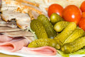Pickles with cold meats and tomatoes Royalty Free Stock Photos