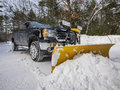 Pickup truck plowing snow during new england winter Royalty Free Stock Photo
