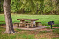 Picnic area with table and grill in the park Stock Photo