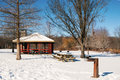 Picnic area after winter snowfall a in loantaka county park in suburban new jersey is covered with pure white snow a water Royalty Free Stock Photo