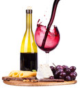 Picnic background with wine and food lunch on a wooden board including a bread cheese olives jamon grapes Royalty Free Stock Photo