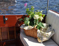 Picnic basket on a boat Royalty Free Stock Photography