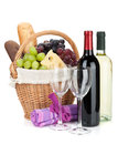 Picnic basket with bread cheese grape and wine bottles isolated on white background Royalty Free Stock Image
