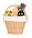 Picnic basket with bread cheese grape and wine bottles isolated on white background Stock Image