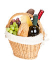 Picnic basket with bread cheese grape and wine bottles isolated on white background Royalty Free Stock Photo