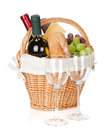 Picnic basket with bread cheese grape and wine bottles two glasses isolated on white background Stock Photo