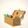Picnic basket with fruit vegetables and wine bread Stock Photo