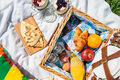 Picnic Basket With Fruits, Orange Juice, Croissants, Quesadilla And No Bake Blueberry And Strawberry Cheesecake Royalty Free Stock Photo