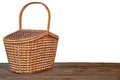 Picnic basket or hamper on wooden table isolated closed the brown rustic white background front view copy space Stock Photography