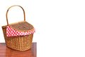 Picnic basket on the outdoor wood table isolated close up wicker or hamper white background Stock Images