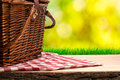 Picnic basket on the table and nature background Royalty Free Stock Images
