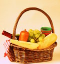 Picnic basket wine fruit cheese and sausage toned photo Royalty Free Stock Image