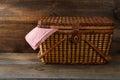 Picnic basket on wood Stock Image