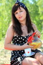 Picnic beautiful woman sitting on the blanket outdoors at park retro style Royalty Free Stock Images
