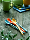 Picnic, color dishware on wooden Royalty Free Stock Images