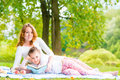 Picnic happy incomplete family in the park Royalty Free Stock Photo