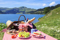 Picnic and lake in french alpine mountains with Royalty Free Stock Image