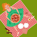 Picnic with pizza cute cartoon girl sitting on a checked table cloth on the grass holding a on her lap Royalty Free Stock Photography