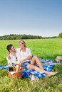Picnic - Romantic couple in sunny meadows Royalty Free Stock Image