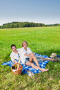 Picnic - Romantic couple in sunny meadows Stock Images