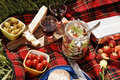 Picnic serie with diffferent sorts of snacks on a blanket Royalty Free Stock Photography