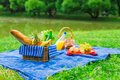 Picnic setting with white wine, pears, fruits, Royalty Free Stock Photo