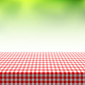 Picnic table covered with checkered tablecloth Royalty Free Stock Photo