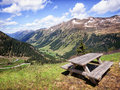 Picnic table at the european alps Royalty Free Stock Images
