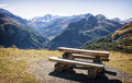 Picnic table at the european alps Royalty Free Stock Image