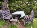 Picnic table at a forest Royalty Free Stock Photos