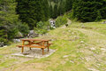 Picnic table in the Italian Alps Stock Image