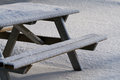 Picnic table in winter snow covered Royalty Free Stock Photography